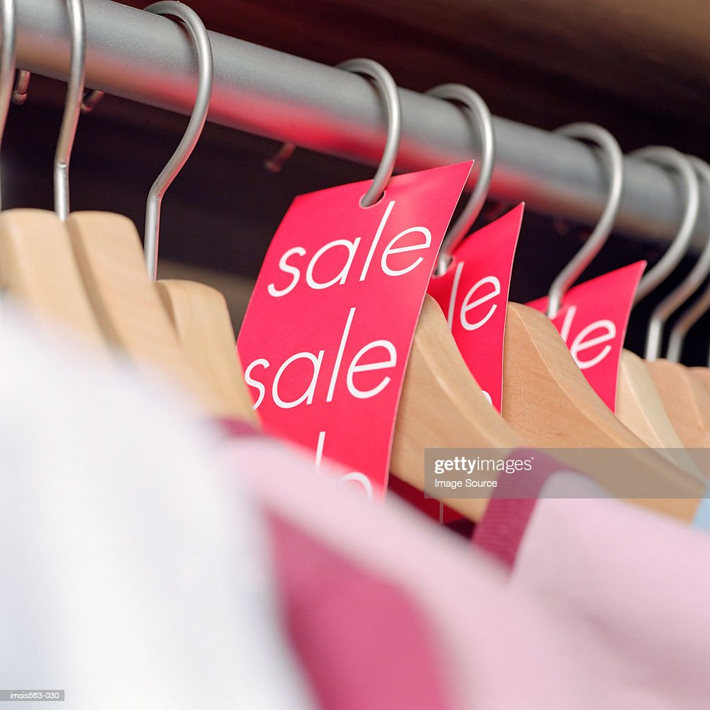 sale labels on clothes hangers stock photo getty images