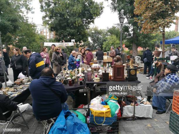 Sale of antiques on the streets of the Rastro in Madrid Spain
