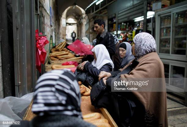 Sale of bread at a market stall street scene in the Muslim quarter of the historic city center of Jerusalem on February 08 2017 in Jerusalem Israel