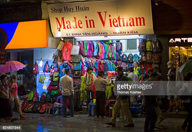 Sale of jackets and backpacks on a shopping street in Hanoi on October 30 2016 in Hanoi Vietnam