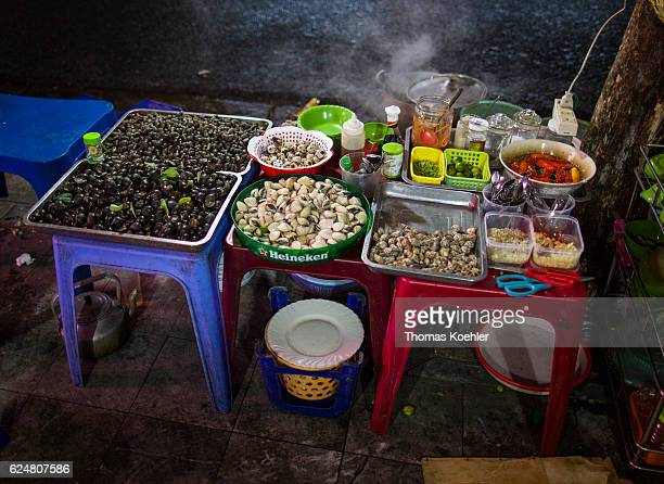 Sale of mussels on a cookshop in Hanoi on October 30 2016 in Hanoi Vietnam