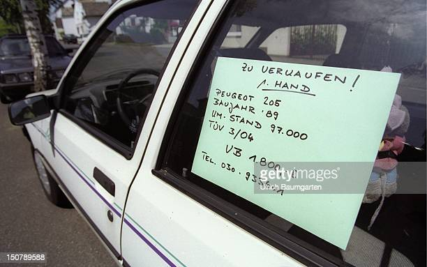 Sale of second hand cars Peugeot 205 with a sign Zu Verkaufen in the windscreen