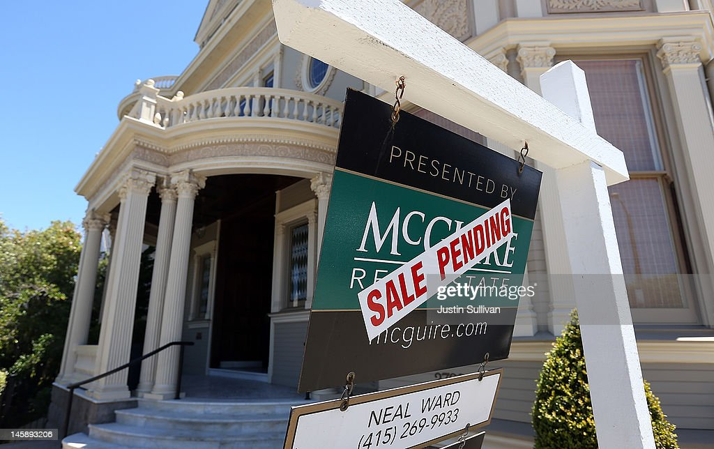 Long Term Mortgage Rates Fall To Historic Lows : News Photo