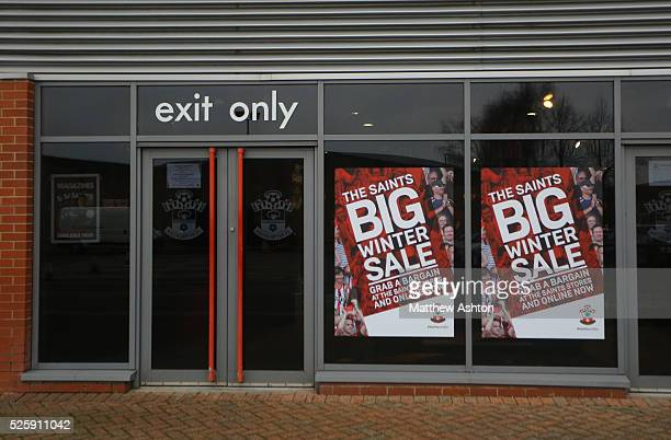 Sale Posters in the window next to the exit of St Mary's stadium Southampton shop