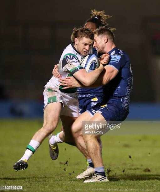 Sale Sharks centre Sam Hill tackles Newcastle Falcons full back Tom Penny during the Gallagher Premiership Rugby match between Sale and Newcastle...