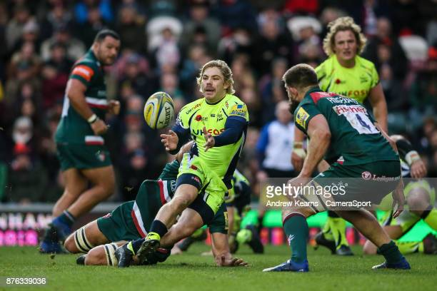 Sale Sharks' Faf de Klerk offloads as Leicester Tigers' Mike Fitzgerald looks on during the Aviva Premiership match between Leicester Tigers and Sale...