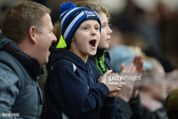 Sale Sharks fan applauds the players during the Aviva Premiership match between Sale Sharks and Bath Rugby at AJ Bell Stadium on December 23, 2017 in...