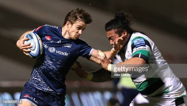 Sale Sharks fly half AJ MacGinty hands off the tackle of Newcastle Falcons forward Logovi'i Mulipola during the Gallagher Premiership Rugby match...