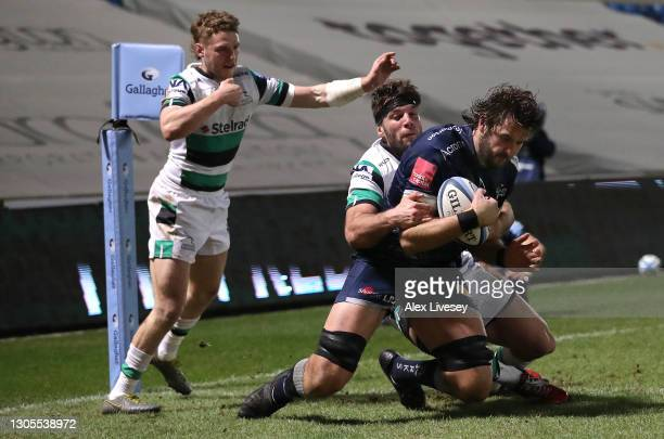 Sale Sharks forward Lood De Jager shrugs off the tackle of Marco Fuser and Tom Penny to cross for the second Sharks try during the Gallagher...