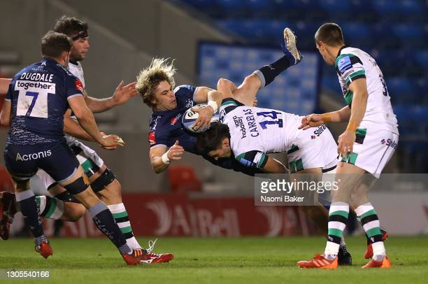 Sale Sharks scrum half Faf de Klerk is upended by Newcastle Falcons wing Mateo Carreras during the Gallagher Premiership Rugby match between Sale and...
