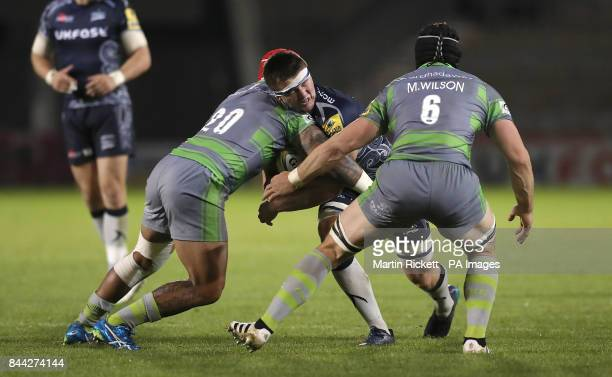 Sale Sharks' Tom Curry is tackled by Newcastle Falcon's Nili Latu and Mark Wilson during the Aviva Premiership match at the AJ Bell Stadium Salford