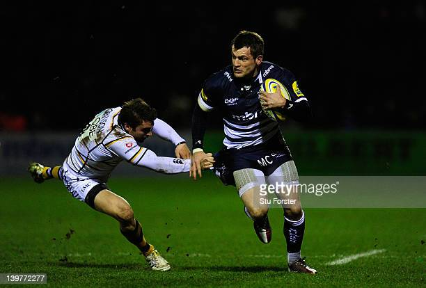 Sale Sharks wing Mark Cueto races through the takle of Nicky Robinson of Wasps during the Aviva Premiership match between Sale Sharks and London...