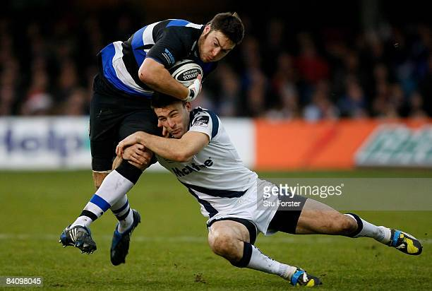 Sale Sharks winger Chris Bell tackles Matt Banahan of Bath during the Guinness Premiership match between Bath and Sale Sharks at The Recreation...