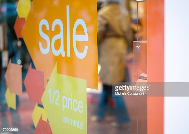 sale sign in shop window - typographies stock photos and pictures