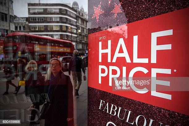 A sale sign is displayed in a store on Oxford Street on December 23 2016 in London England Shoppers are continuing to spend as stores offer bargains...