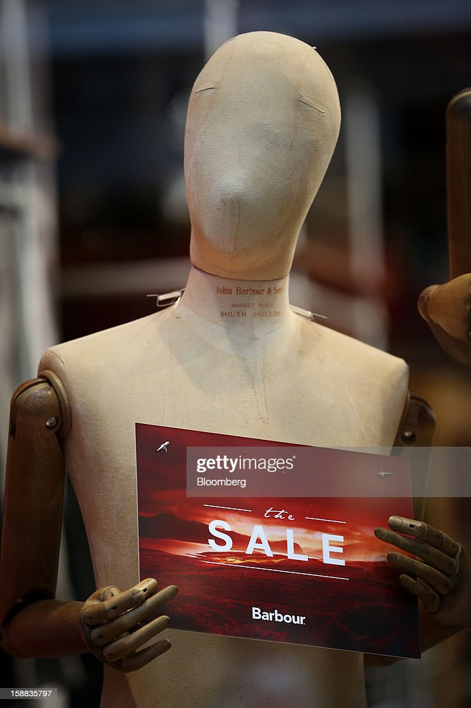 A sale sign is displayed on a mannequin inside a J. Barbour & Sons Ltd. clothing store in the Covent Garden district of London, U.K., on Monday, Dec. 31, 2012. The number of Britons making shopping trips for post-holiday bargains barely increased on the day after Christmas as more people sought discounts online. Photographer: Jason Alden/Bloomberg via Getty Images