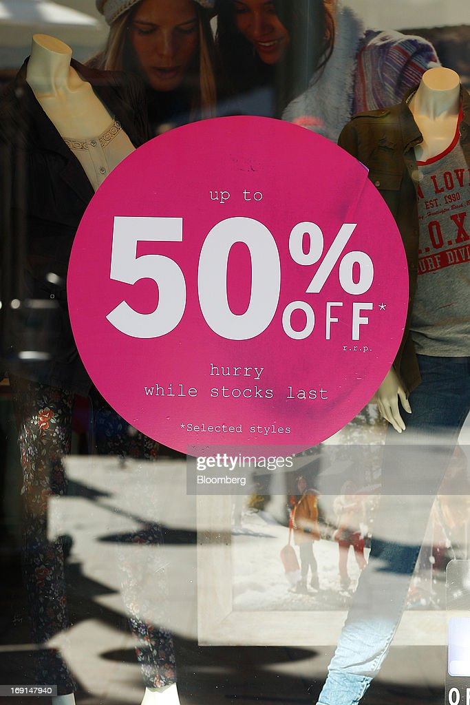 A sale sign is displayed on the window of a store in the Manly area of Sydney, Australia, on Sunday, May 19, 2013. The Reserve Bank of Australia cut its benchmark interest rate to a record low this month to boost businesses weakened by the currency's sustained strength, even as households reacted to earlier reductions. Photographer: Brendon Thorne/Bloomberg via Getty Images