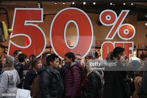 A sale sign on Oxford Street displays 50 percent off during the Boxing Day sales on December 26 2015 in London England Boxing Day is one of the...