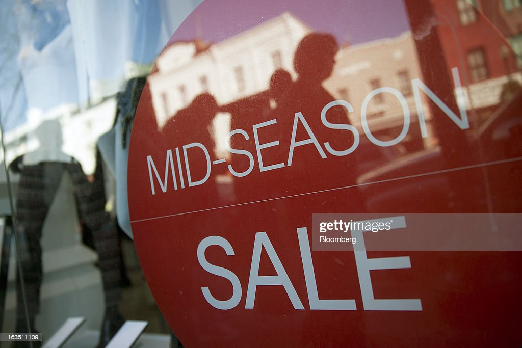 A sale sign sits inside the window of a Hennes & Mauritz AB (H&M) retail store in the Georgetown neighborhood of Washington, D.C., U.S., on Saturday, March 9, 2013. The U.S. Census Bureau is expected to release advance retail sales data for February on March 13. Photographer: Andrew Harrer/Bloomberg via Getty Images