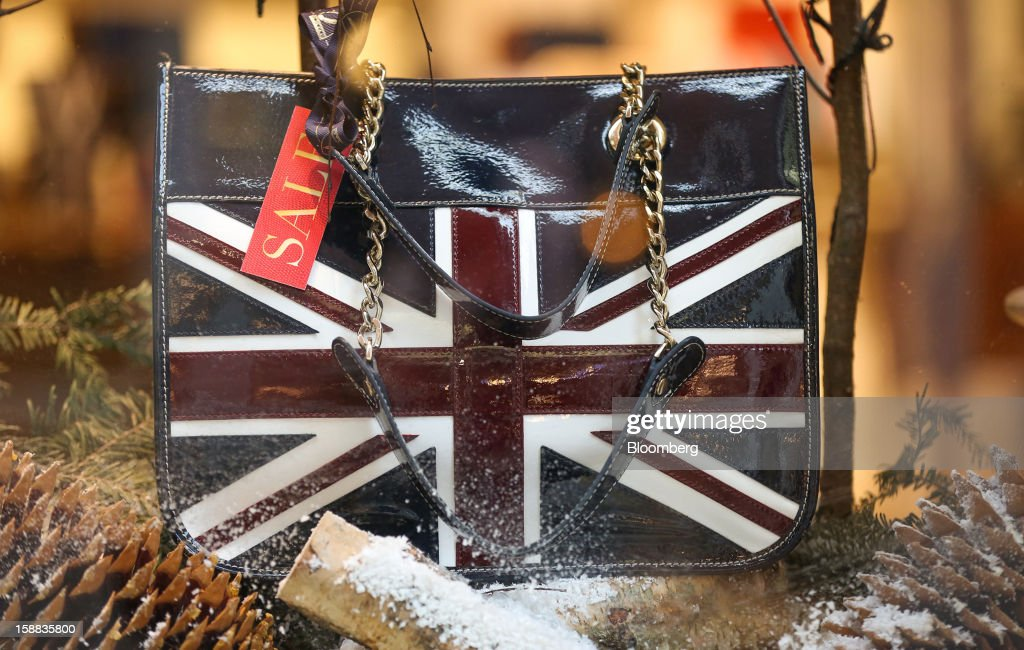A sale sign sits on a handbag with a Union Jack design in a Radley and Co. Ltd. store in the Covent Garden district of London, U.K., on Monday, Dec. 31, 2012. The number of Britons making shopping trips for post-holiday bargains barely increased on the day after Christmas as more people sought discounts online. Photographer: Jason Alden/Bloomberg via Getty Images