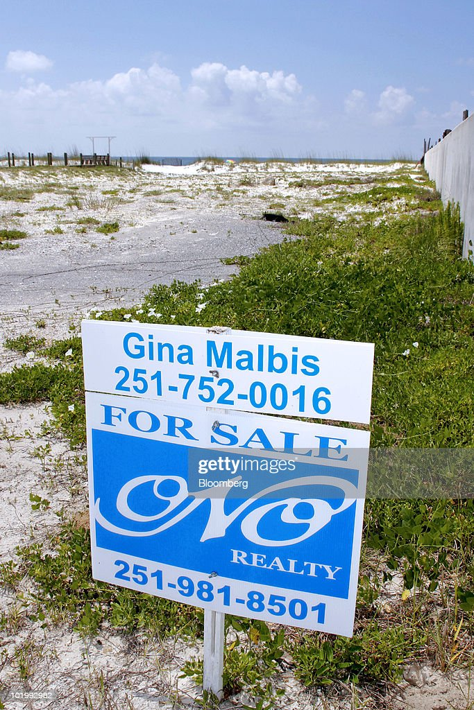A sale sign sits outside a beachfront home along the Gulf of Mexico