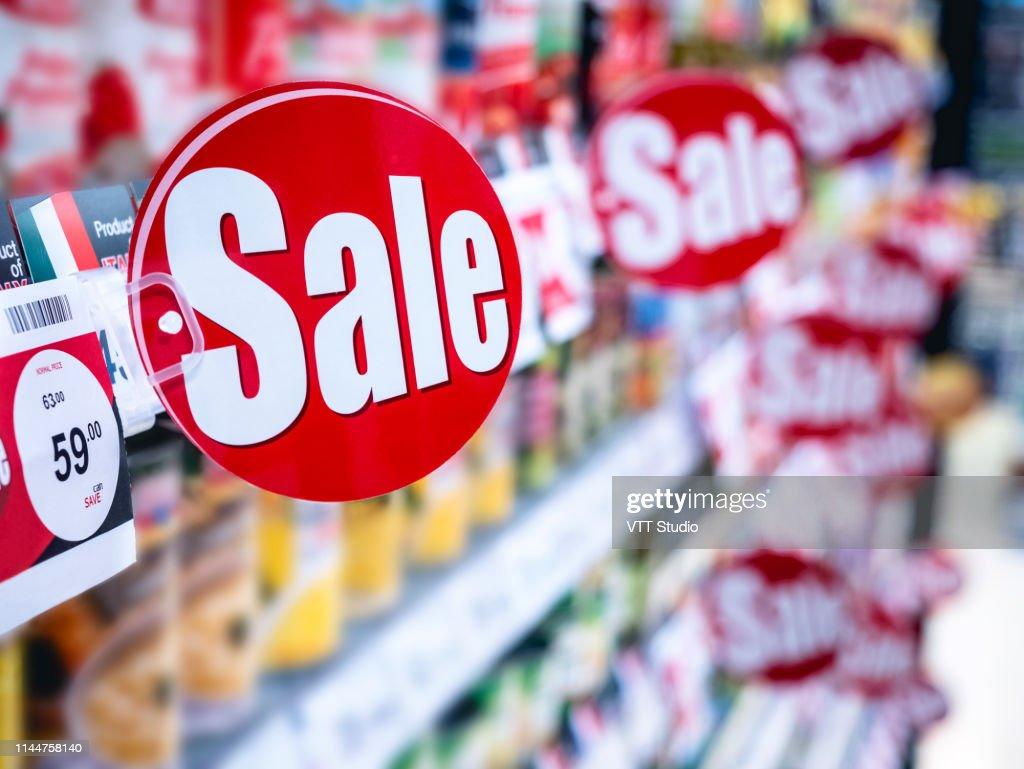 Sale signage Supermarket shelf Marketing Promotion Discount : Stock Photo