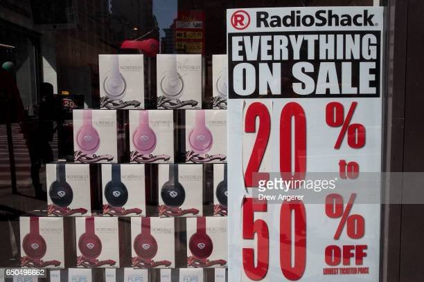 Sale signs hang in the window of a RadioShack storefront in the Chelsea neighborhood March 9 2017 in New York City RadioShack has filed for...