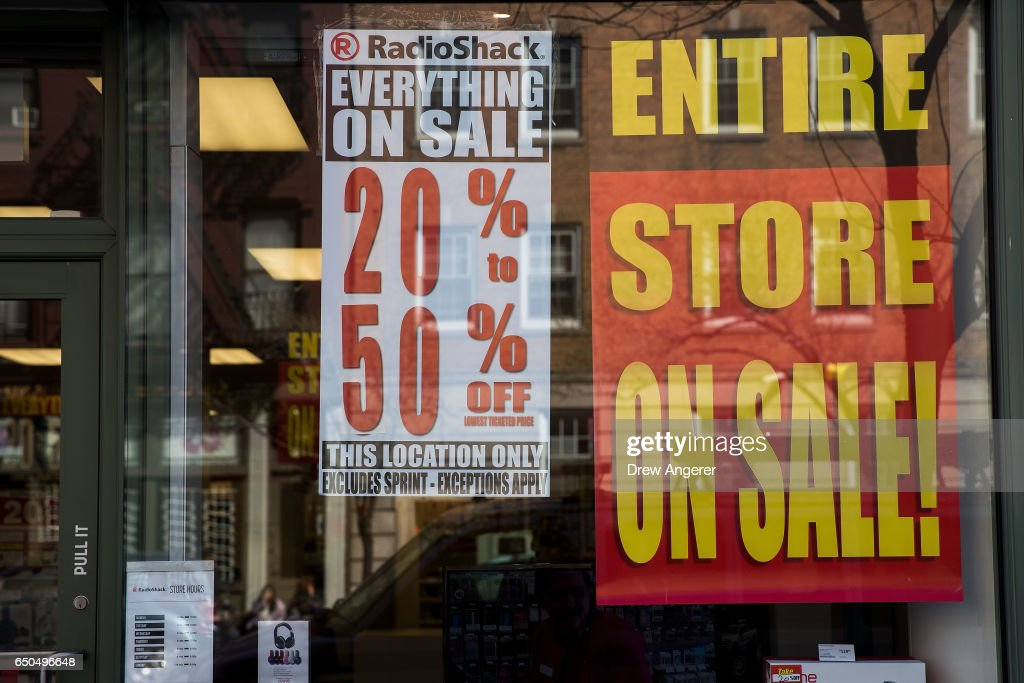 Sale signs hang in the window of a RadioShack storefront in the West