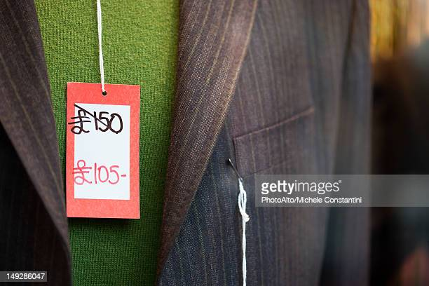 sale tag on clothing - price tag stock pictures, royalty-free photos & images