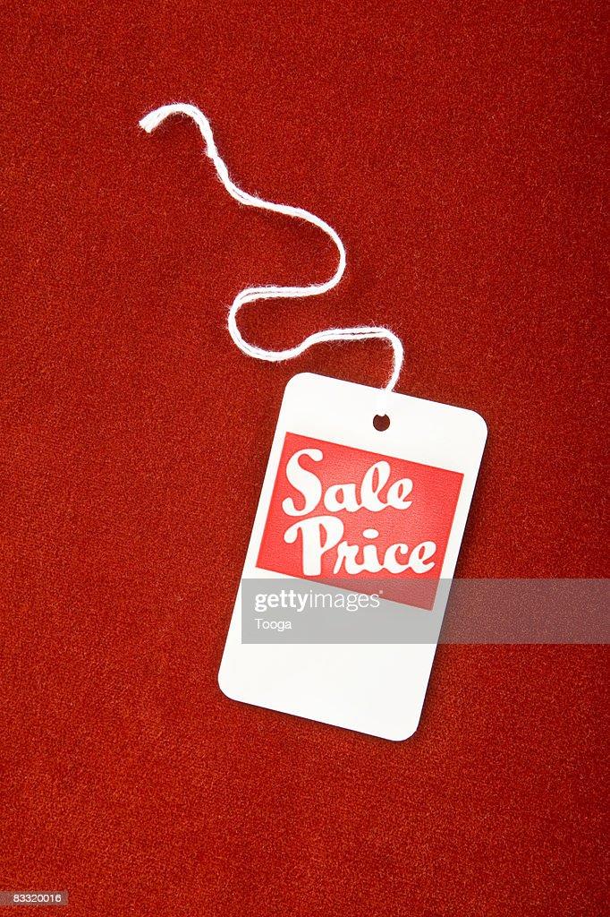 Sale tag on red velvet : Bildbanksbilder