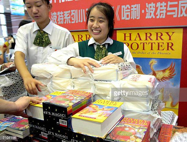 Salegirls at a bookshop begin selling copies of 'Harry Potter and the Order of the Phoenix' author JK Rowling's fifth installment in her popular...