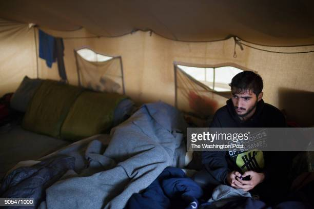 Saleh 22 a Syrian refugee rests in his tattered tent in an olive grove next to the Moria refugee camp He has been living in Moria for the past 6...
