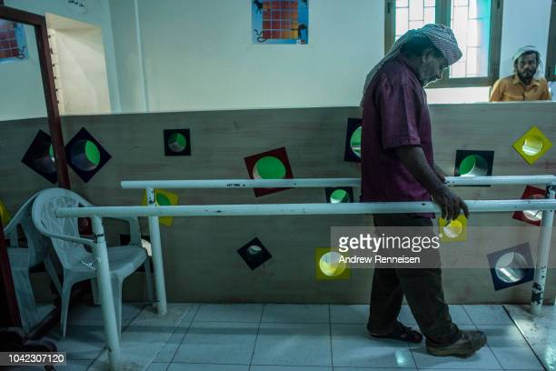 Saleh alHadi tests a prosthetic leg at a government health clinic on September 24 2018 in Aden Yemen AlHadi was injured by a landmine during fighting...