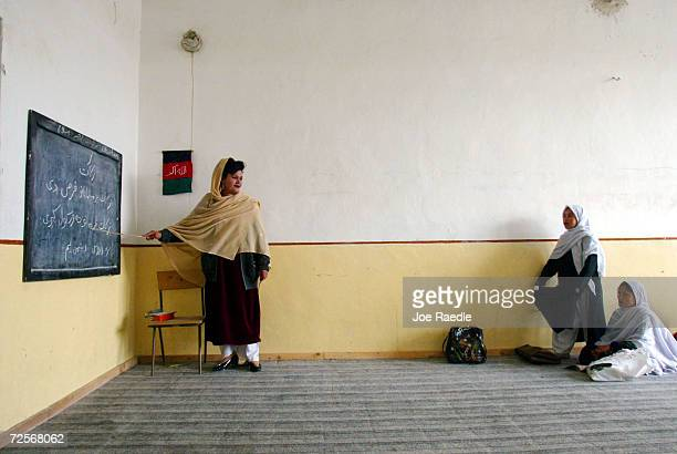 Saleha addresses her first grade class from the black board during a lesson February 25 2002 in Kandahar Afghanistan The Zhargona Ana high school for...