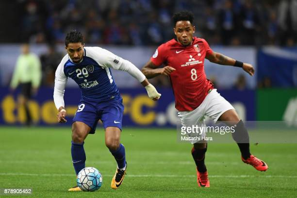 Salem Al Dawsari of AlHilal and Rafael Silva of Urawa Red Diamonds compete for the ball during the AFC Champions League Final second leg match...