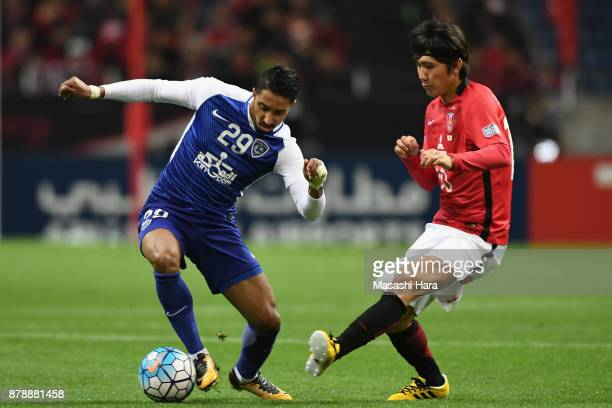 Salem Al Dawsari of AlHilal and Yosuke Kashiwagi of Urawa Red Diamonds compete for the ball during the AFC Champions League Final second leg match...