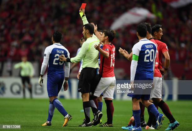 Salem Al Dawsari of AlHilal is shown a red card by referee Ravshan Irmatov during the AFC Champions League Final second leg match between Urawa Red...
