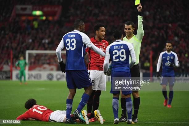 Salem Al Dawsari of AlHilal is shown a yellow card by referee Ravshan Irmatov during the AFC Champions League Final second leg match between Urawa...