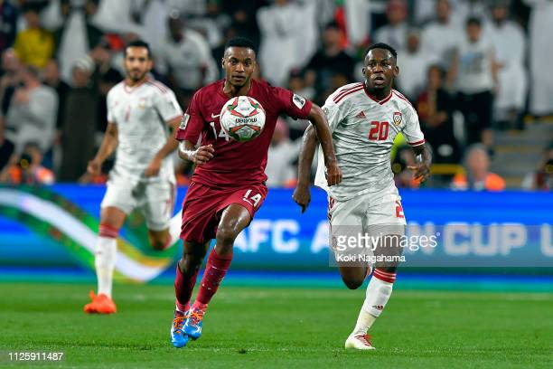 Salem Al Hajri is tackled by Saif Rashid Alshemeili of the UAE during the AFC Asian Cup semi final match between Qatar and United Arab Emirates at...