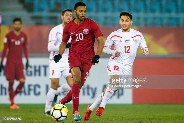 Salem Al Hajri of Qatar in action against Elkayed Mohammed of Palestine during the AFC U23 Championship China 2018 Quarter Finals match between Qatar...