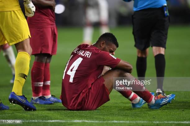 Salem Al Hajri of Qatar lies injured during the AFC Asian Cup semi final match between Qatar and United Arab Emirates at Mohammed Bin Zayed Stadium...