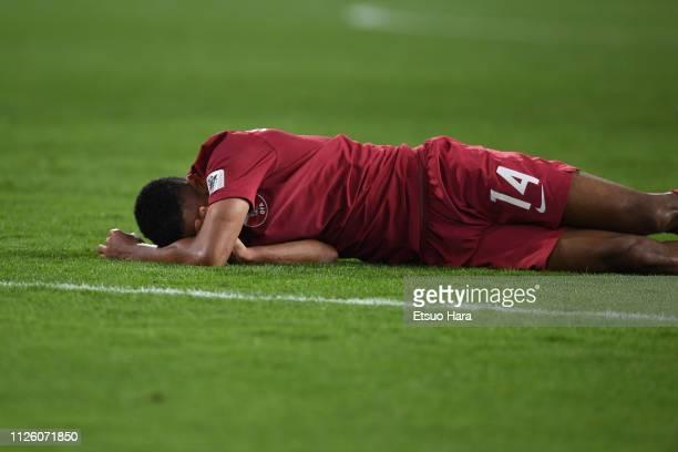 Salem Al Hajri of Qatar lies injured the AFC Asian Cup semi final match between Qatar and United Arab Emirates at Mohammed Bin Zayed Stadium on...