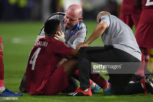 Salem Al Hajri of Qatar receives medical treatment during the AFC Asian Cup semi final match between Qatar and United Arab Emirates at Mohammed Bin...