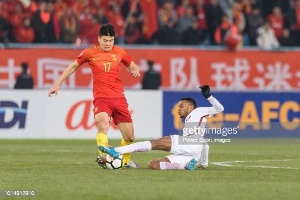 Salem Al Hajri of Qatar trips up with Yang Liyu of China during the AFC U23 Championship China 2018 Group A match between China and Qatar at...