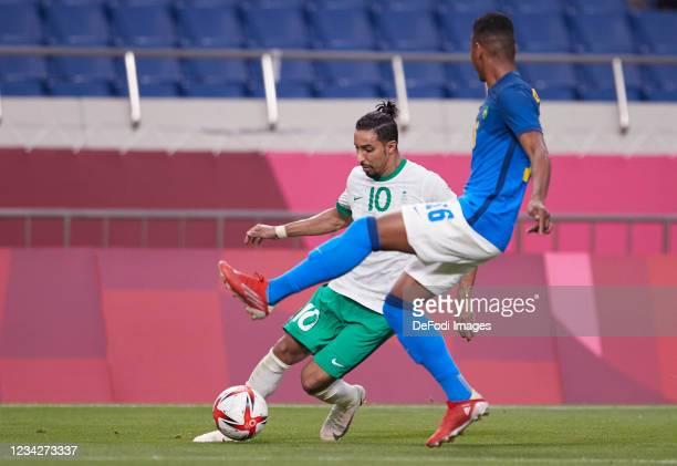 Salem Al-Dawsari of Saudi Arabia and Abner of Brazil battle for the ball during the Men's Group D match between Saudi Arabia and Brazil on day five...