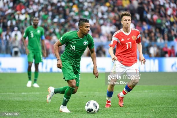 Salem Aldawsari of Saudi Arabia and Aleksandr Golovin of Russia during the 2018 FIFA World Cup Russia group A match between Russia and Saudi Arabia...