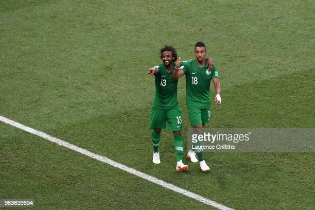 Salem Aldawsari of Saudi Arabia celebrates with teammate Yasir Alshahrani after scoring his team's second goal during the 2018 FIFA World Cup Russia...