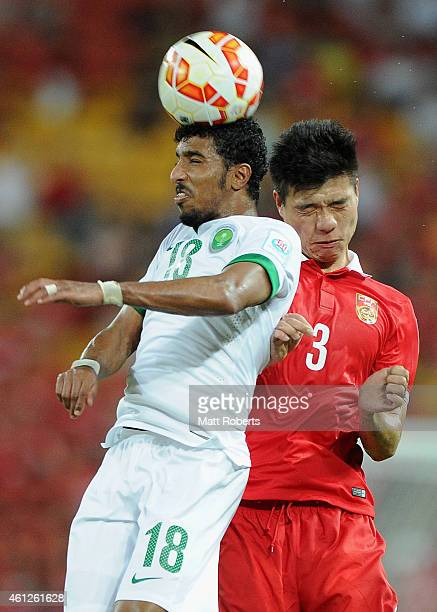 Salem Aldawsari of Saudi Arabia heads the ball in front of Mei Fang of China PR during the 2015 Asian Cup match between Saudi Arabia and China PR at...