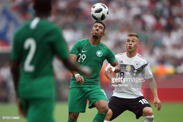 Salem AlDawsari of Saudi Arabia is challenged by Joshua Kimmich of Germany during the international friendly match between Germany and Saudi Arabia...