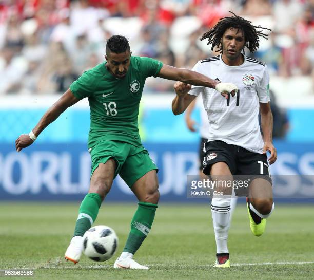 Salem Aldawsari of Saudi Arabia shoots under pressure from Mohamed Elneny of Egypt during the 2018 FIFA World Cup Russia group A match between Saudia...